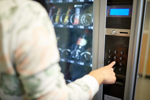 Person using vending machine at hotel
