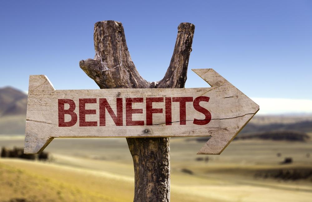 Benefits wooden sign on desert background.jpeg