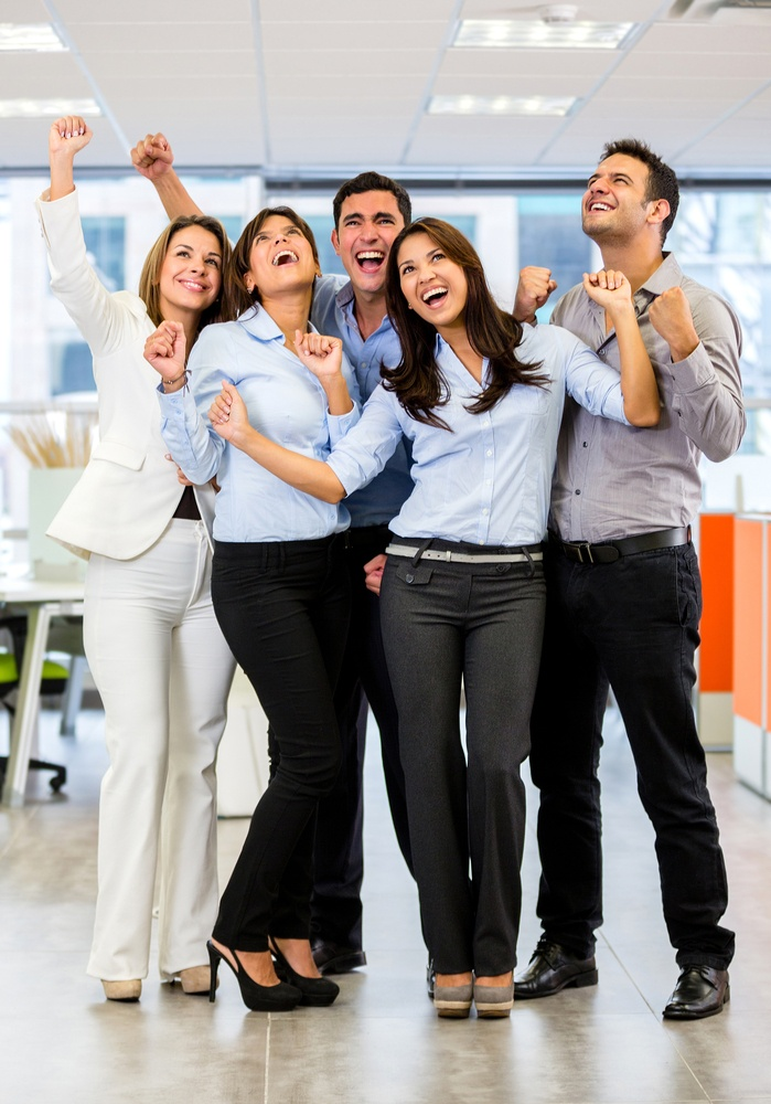 Business group with arms up celebrating their success.jpeg