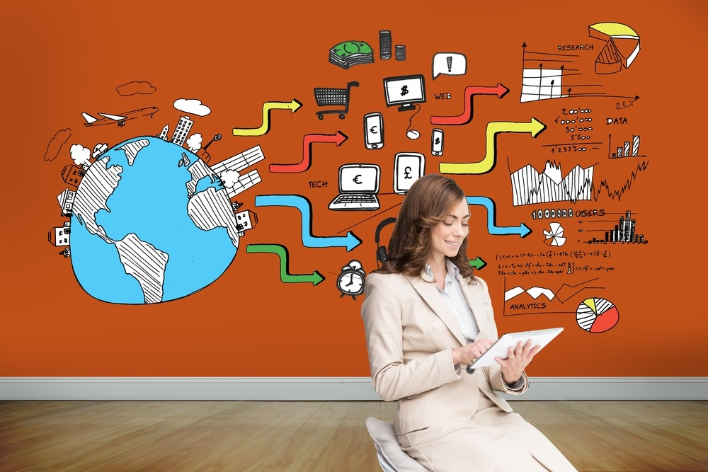 Composite image of pleased businesswoman using a tablet pc sitting on chair in front of orange wall showing economic illustrations.jpeg