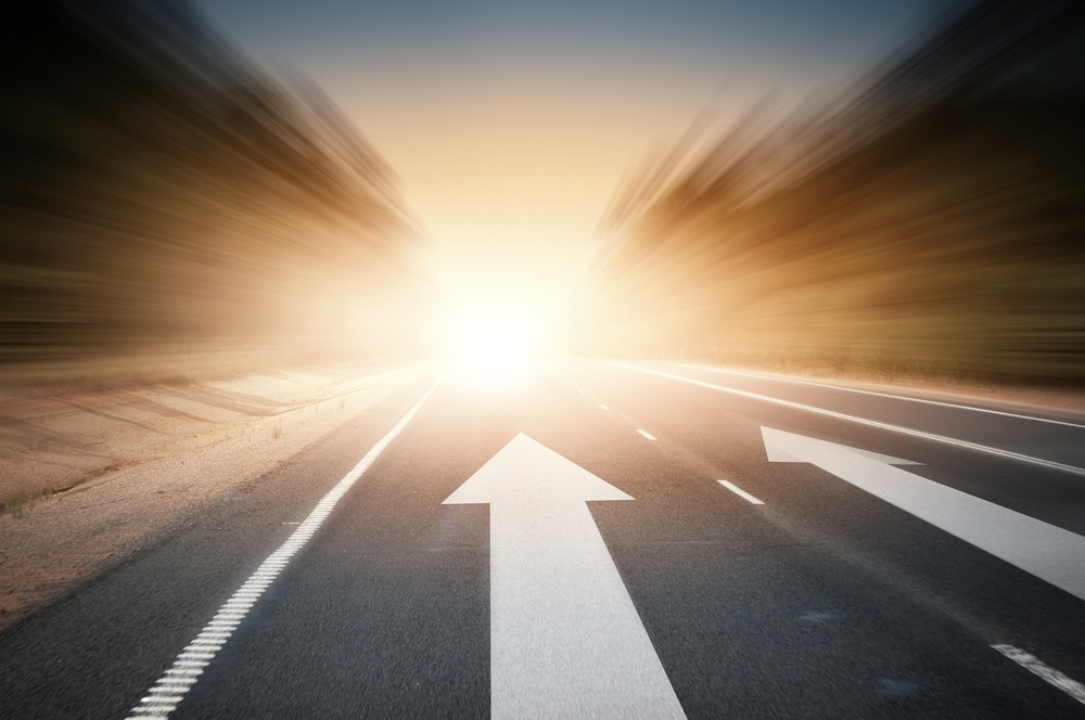 Conceptual image of asphalt road and direction arrow.jpeg