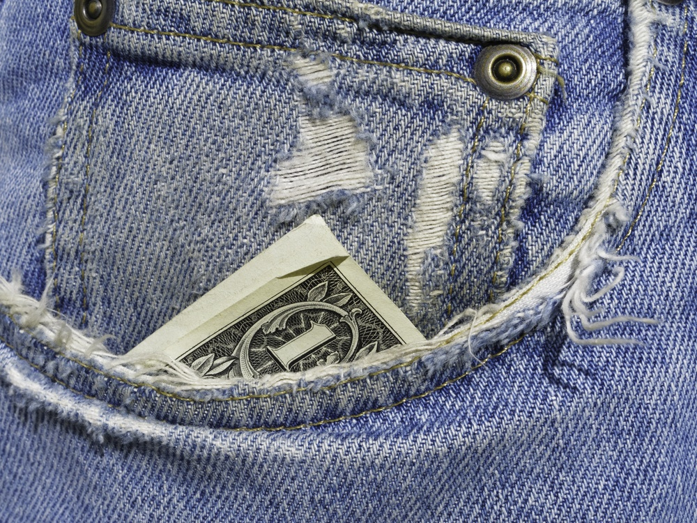 Down to the last dollar in frayed right pocket of blue jeans.jpeg